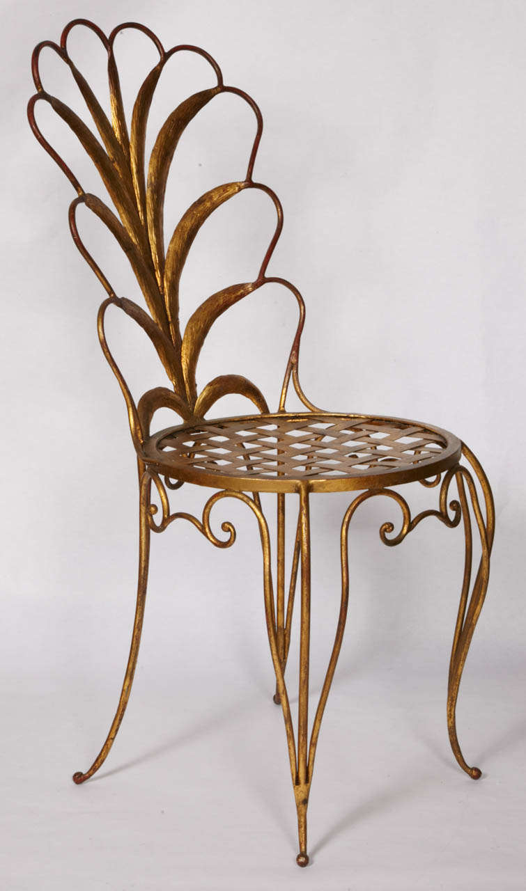 1040's pair of chairs in gilt iron by French designer René Drouet.