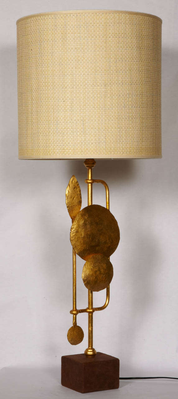 Pait of gilt wrought iron lamps on leather base