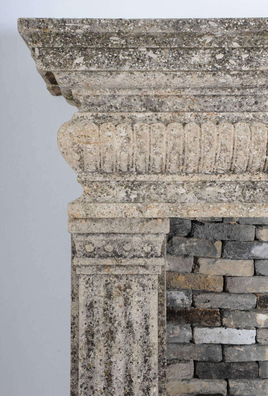 A limestone Italian Renaissance style fireplace and a monumental 16th century French wrought iron fireback 3