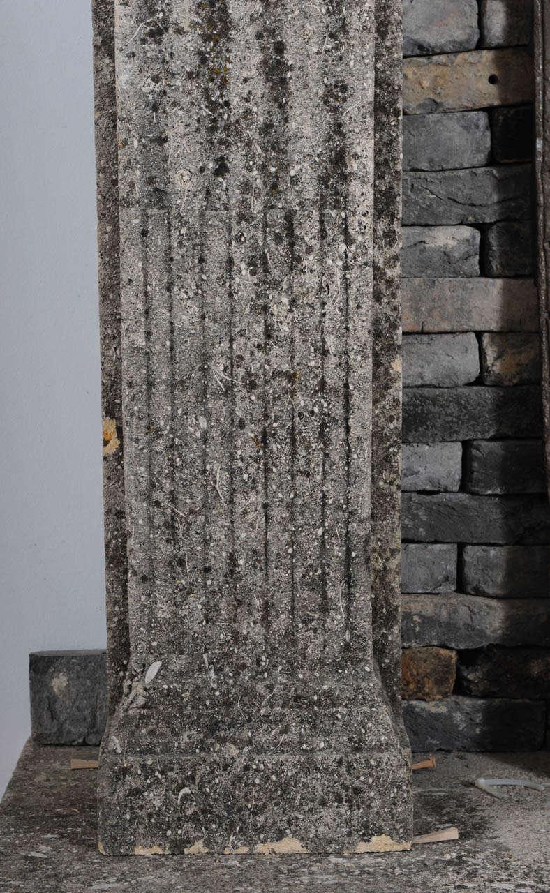 A limestone Italian Renaissance style fireplace and a monumental 16th century French wrought iron fireback 5