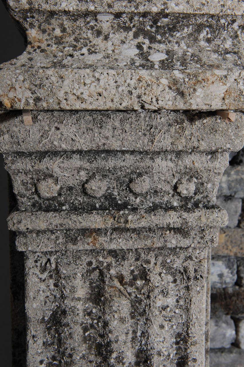 A limestone Italian Renaissance style fireplace and a monumental 16th century French wrought iron fireback 7