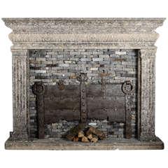 An 18th century limestone Italian  fireplace