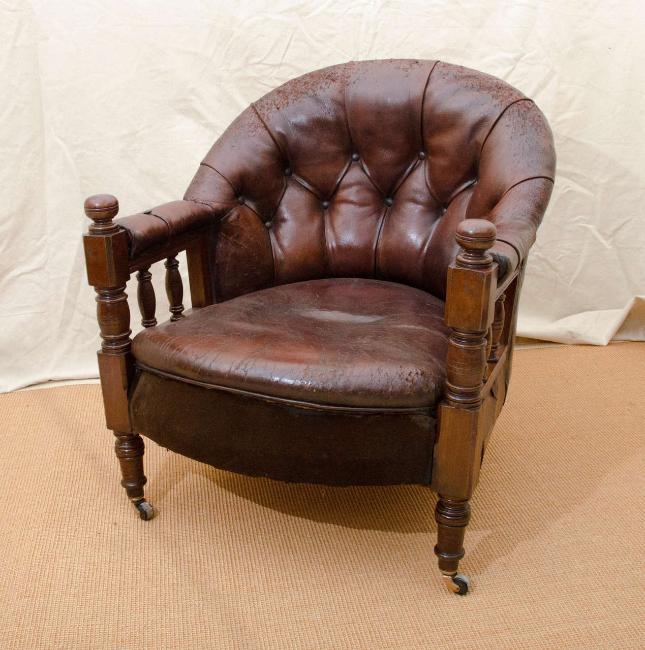 English Victorian Tufted Leather Barrel Back Spindle Support Open Armchair.  The Chair Is Mahogany Framed