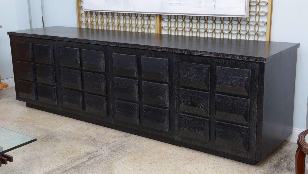The rectangular top above four doors with pyramidal lozenges overall on the doors, the finish in cerused ebonized matte Custom designed by renowned designer Jamie Herzlinger Designer Jamie Herzlinger, has established herself as a sought-after and