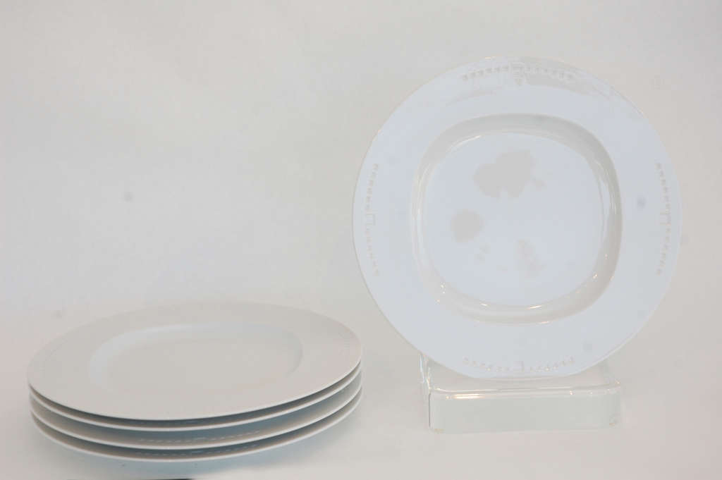 A clean, contemporary china design, this group of five plates in the