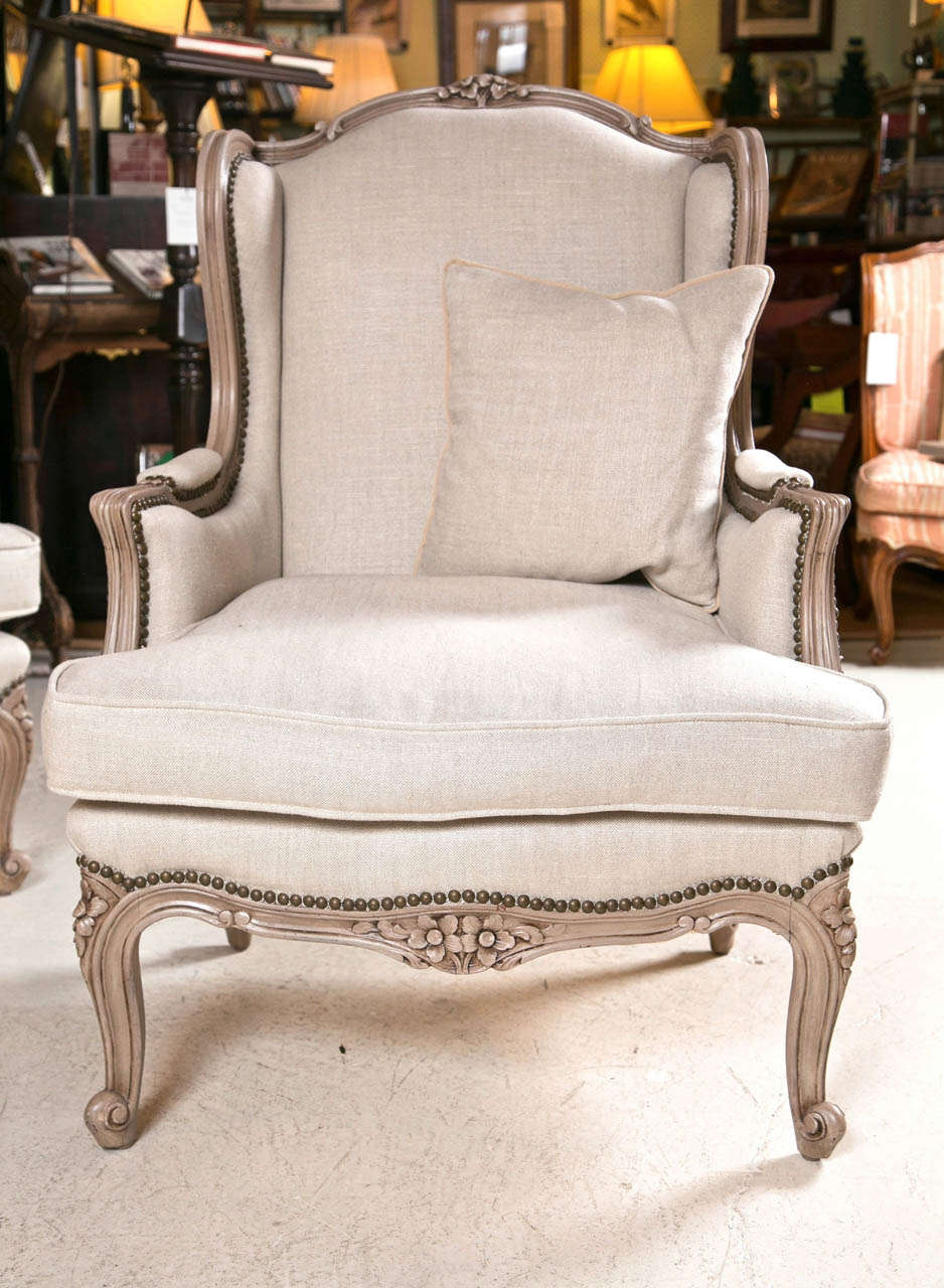 This pair of large burmese arm chairs is no longer available - Pair Of French Wingback Chairs In Linen Upholstery With Nail Heads 2