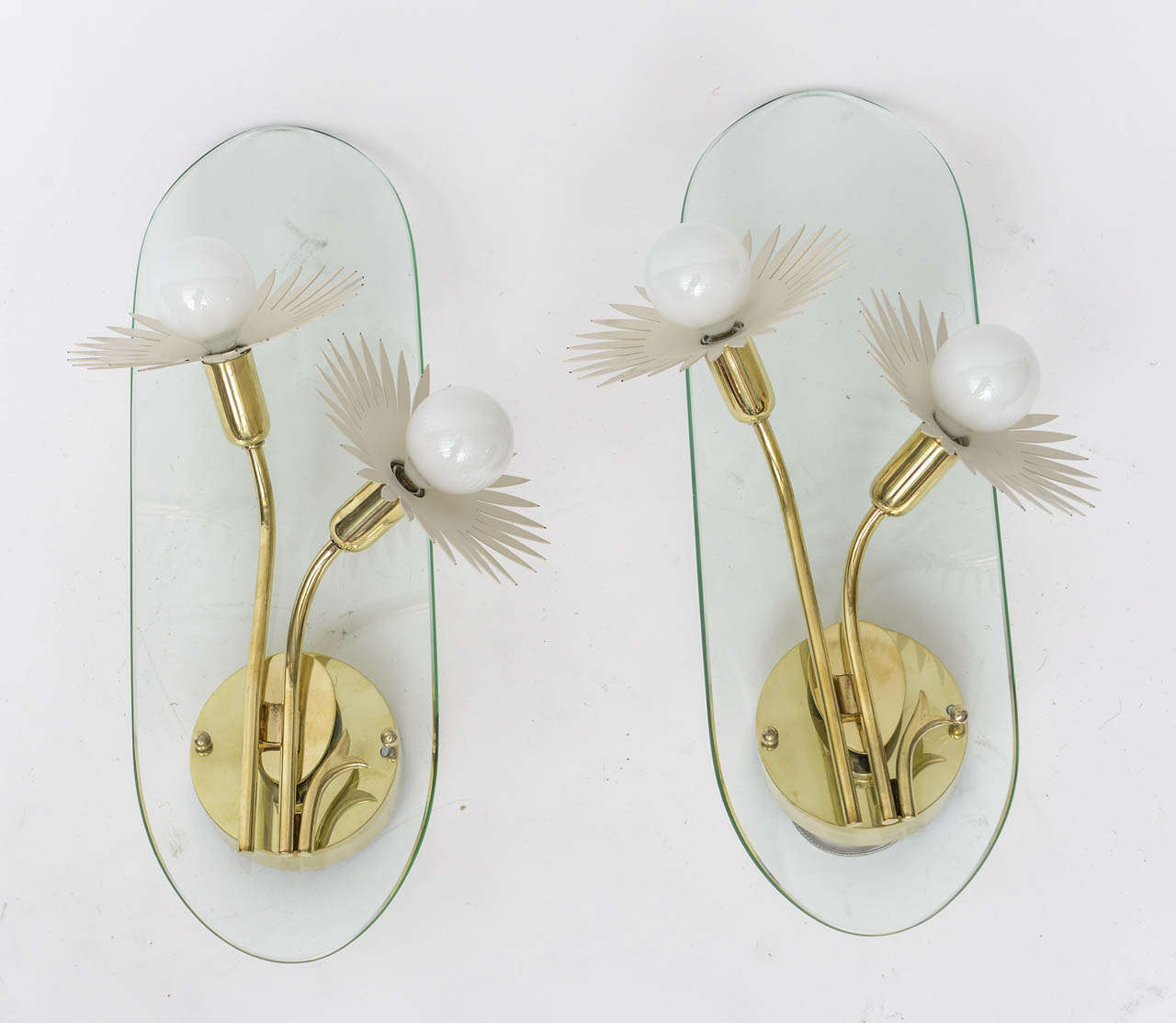 1950s Italian brass and glass wall sconces in the manner of Pietro Chiesa for Fontana Arte, with whimsical white enameled flower sockets. Professionally polished and re-wired.