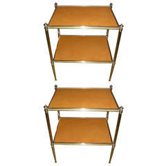 A pair of two-tiered end tables