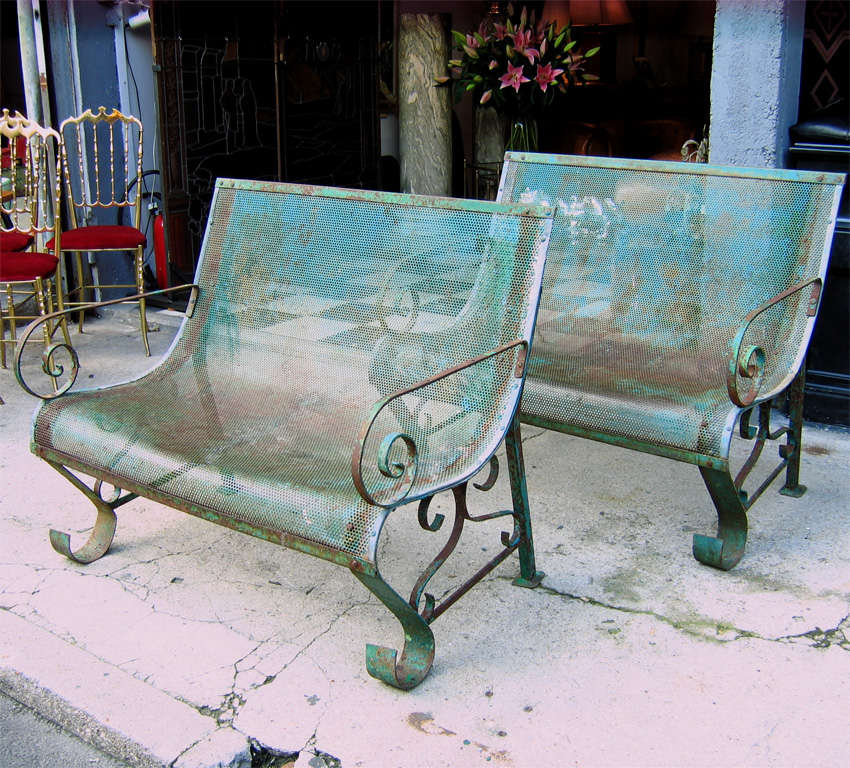Two 1950s iron benches in their original green patina.