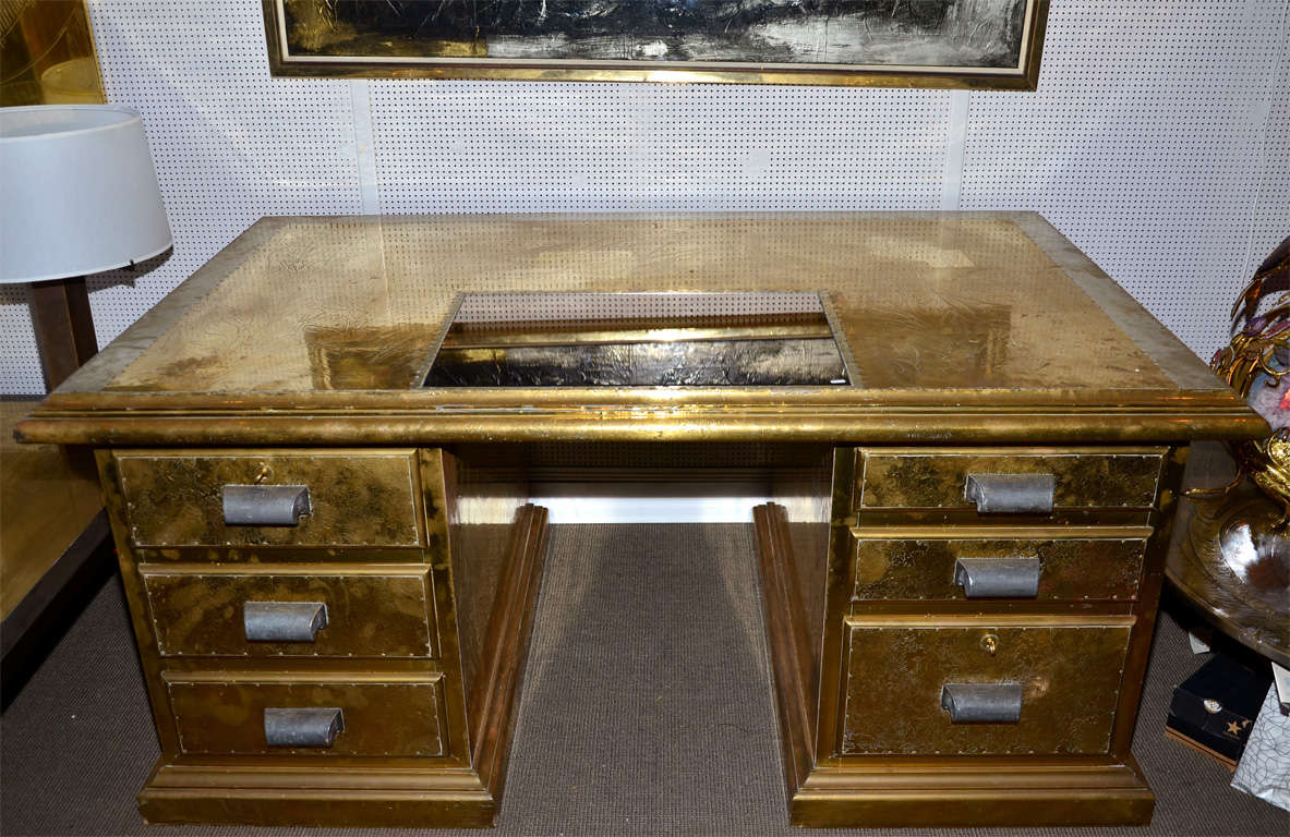 1970s desk signed by R. Dubarry, in engraved brass, with six drawers and a smoked mirror top surface.