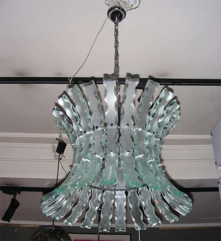 Italian chandelier by Zero Quattro, in molded frosted glass worked on a wheel, and chrome metal structure. Four lights.