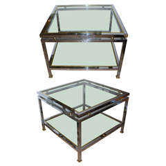 A pair of two-tiered end tables in chromed metal