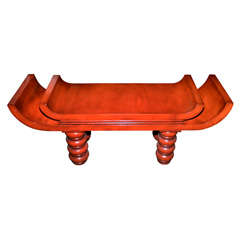 An unusual red lacquered  bench in the style of Tony Duquette .