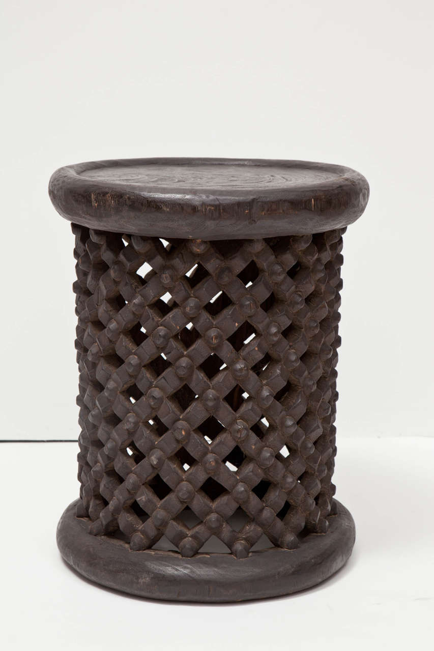 African tall drum stool or table originating from Cameroon. Featuring spider's nest design. Made of tropical hardwood in an ebony finish.