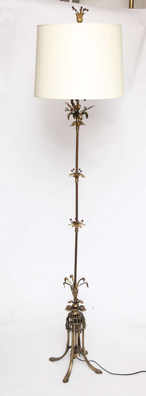 A 1920s sculptural Art Deco patinated brass foor lamp. Shade not included