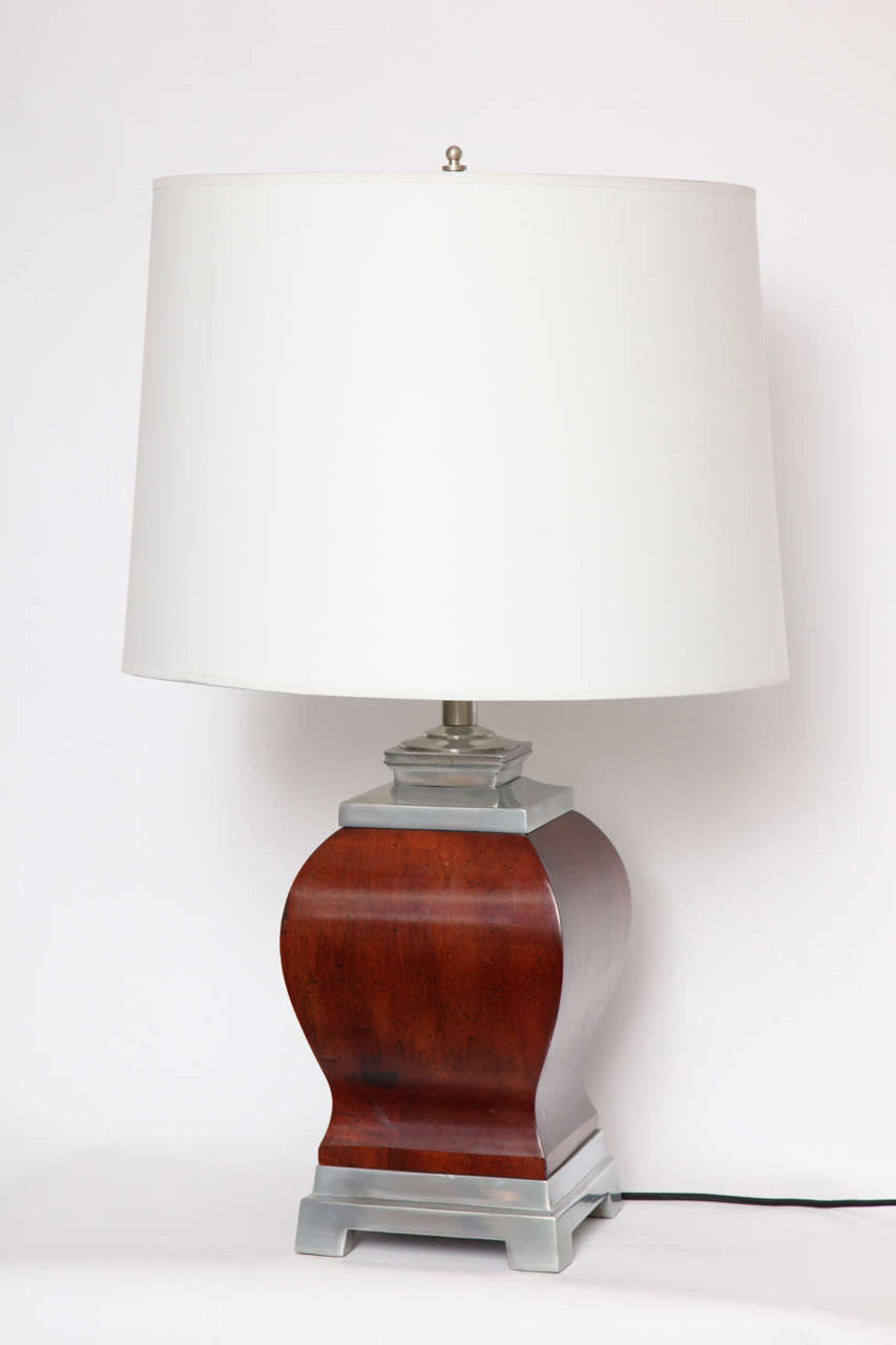 A pair of 1940s art moderne table lamps, the classical modern forms crafted of lacquered wood and nickel.