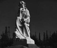 Cemetery Statue and Oil Derricks. Long Beach, CA 1939