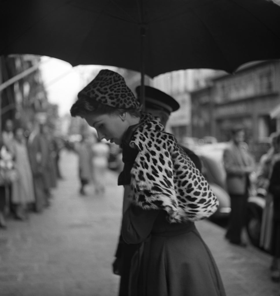 Georges Dambier Black and White Photograph - Suzy Parker, Etole Leopard, Paris 1952
