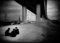 Conspiratorial schoolboys underneath expressway, Shin Koiwa, Tokyo