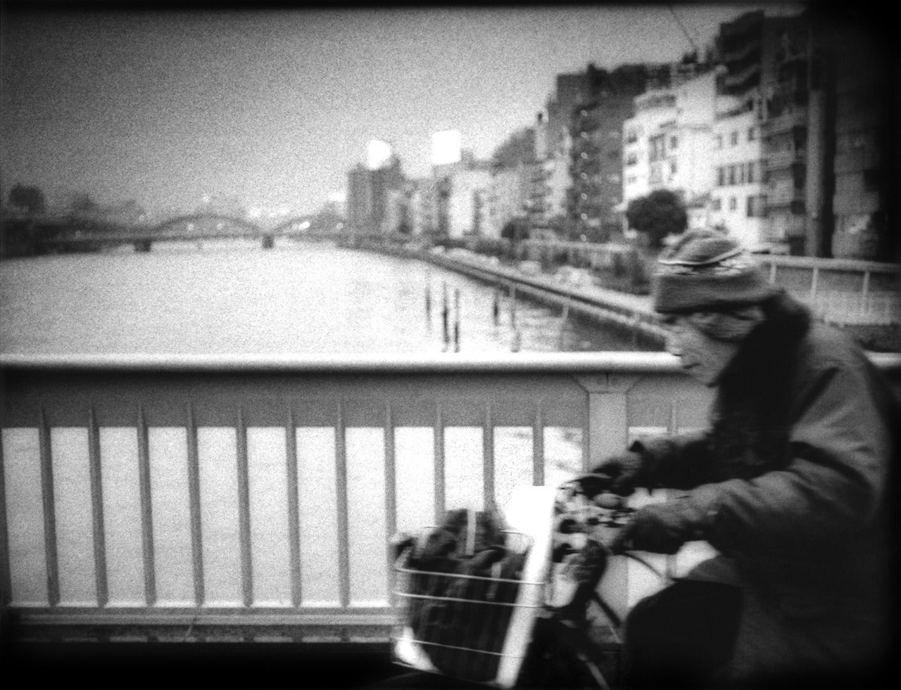 Cycling across Sumida River Bridge in Ueno, Tokyo