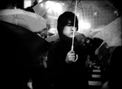 Under umbrella in nighttime rain, Hachiko Shibuya, Tokyo