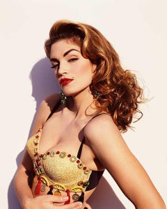 Cindy Crawford, portrait of the supermodel dressed in a golden bustier