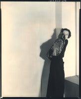 Paulette Godard in fur jacket.