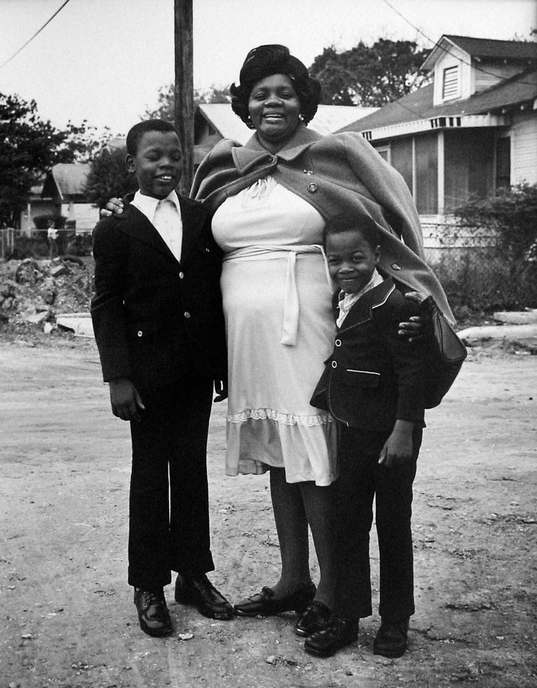 Earlie Hudnall Jr. Black and White Photograph - Mother with Sons, 3rd Ward, Houston, TX