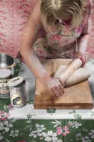 Secret Recipe: Contemporary Figurative Photograph of 1950's Housewife in Pink