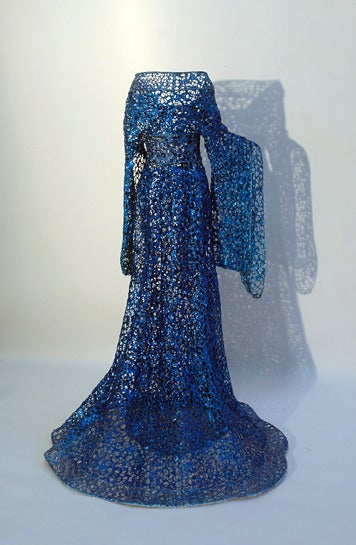 Part of Defrancesca's exquisite life-size high fashion gown series. The lacy shadow cast by the piece becomes a part of the installation. The rich royal blue is luminescent.  Sophie Defrancesca was born in Toronto in 1967, and attended the Ontario