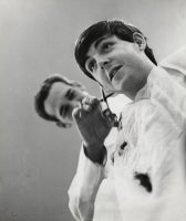 Paul McCartney of the Beatles Having His Hair Cut at Horne Brothers Barbershop, Liverpool