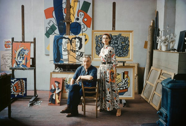 Mark Shaw Color Photograph - Fernand Leger in His Studio With Model Wearing Fabric in the Style of His Work