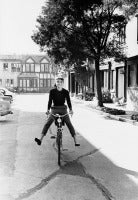 Audrey Hepburn Rides Her Bike to Set