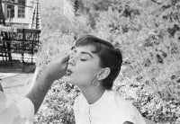 Audrey Hepburn Gets A Touch Up On The Set Of Sabrina