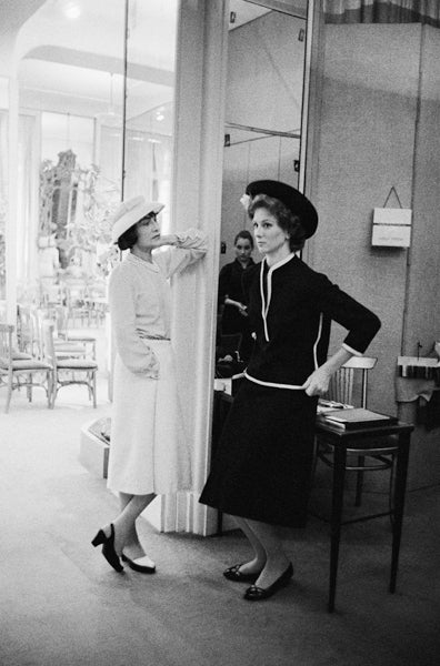 Mark Shaw Black and White Photograph - Coco Chanel with Suzy Parker in a Dark Suit