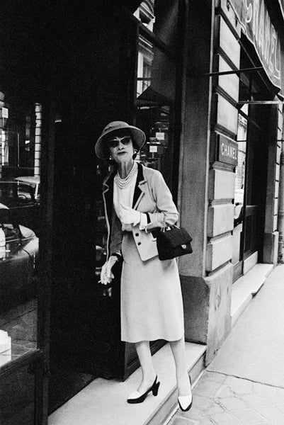 Mark Shaw Black and White Photograph - Coco Enters Her Shop on the Rue Fauborg St. Honore