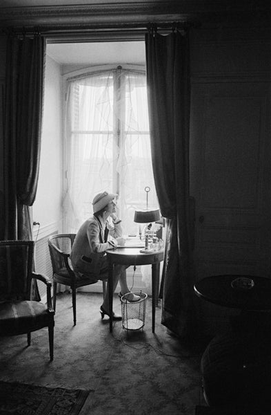 Coco Chanel Writes At Her Desk