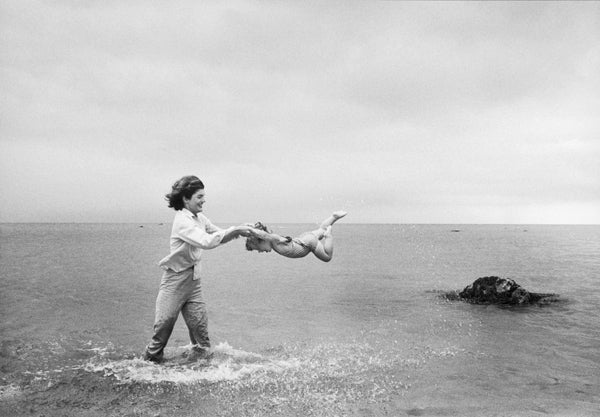 Mark Shaw Black and White Photograph - Jacqueline Kennedy Swings Caroline In The Water At Hyannis Port, Massachusetts