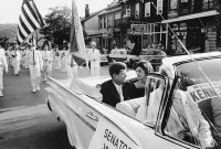 Jacqueline Kennedy and JFK in a Campaign Car