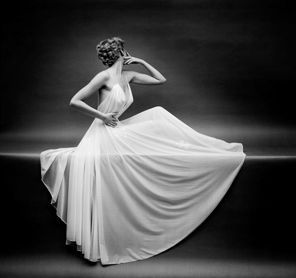 Mark Shaw Black and White Photograph - Vanity Fair Sheer Gown Left Arm Up