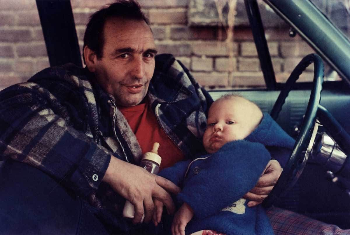 Mark Cohen Man In Red Shirt In Car With Baby Wilkes