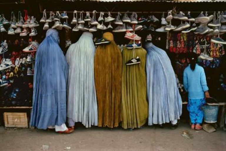 Steve McCurry Color Photograph - Afghan Women at Shoe Store, Kabul, Afghanistan, 1992