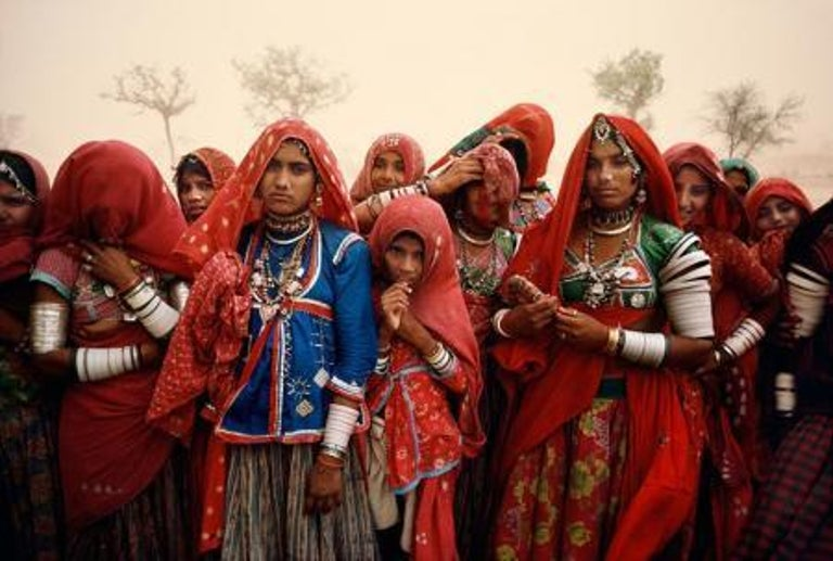 Steve McCurry Figurative Photograph - Cluster of Women During a Dust Storm, Rajasthan, India, 1983