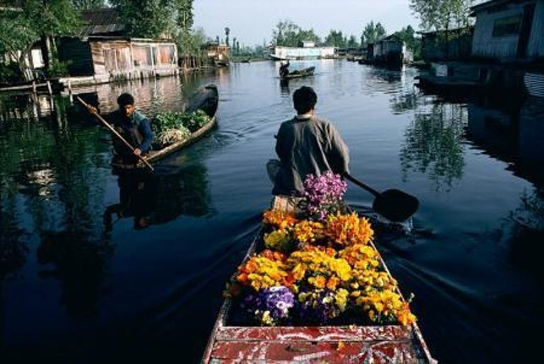 Flower Seller, Kashmir, India, 1998  - Photograph by Steve McCurry