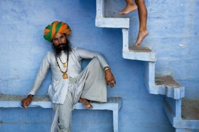 Man Beneath Stairs, Jodphur, India, 2005 - Photograph by Steve McCurry