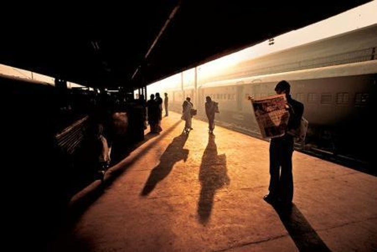 Steve McCurry Color Photograph - Train Station at Old Delhi, India, 1983 - Colour Photography
