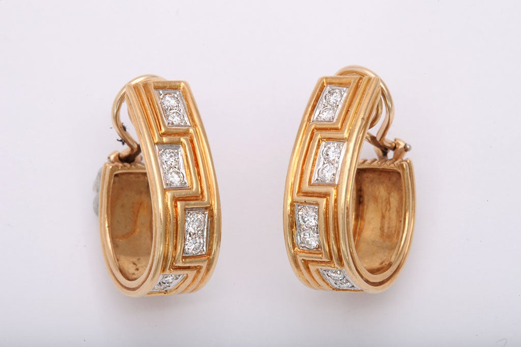 Ultra sophisticated 18kt Yellow Gold Hoop Earrings witha Greek Key Design & set with clean, white, full cut Diamonds.