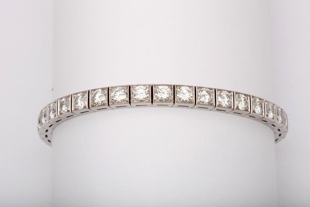 36 near colorless vvsi round diamonds 9.00 carats platinum hand made setting 20.7 grams 10% iridium platinum