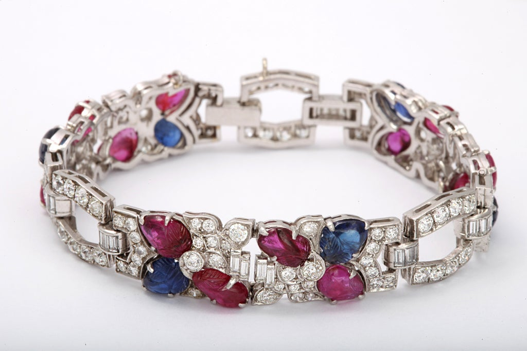 99 round diamonds 5.00 carats 29 baguette diamonds 1.00 6 carved sapphires 12 carved rubies