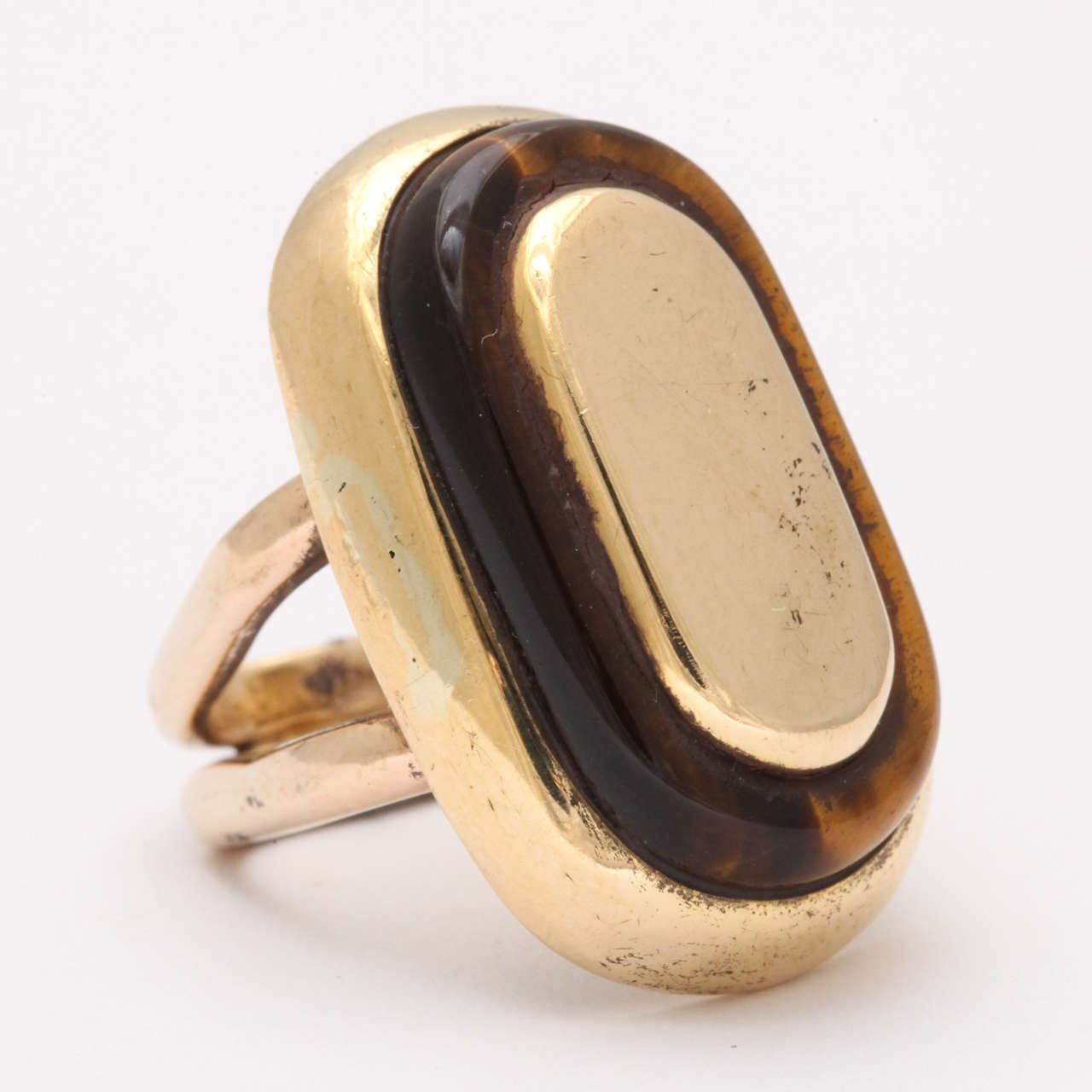 Tiger's Eye and Gold Ring.  Highly Stylized  both in feeling & look.  Fits a size 5 - 5 1/2.  Very sleek mid 50's to early 60's.